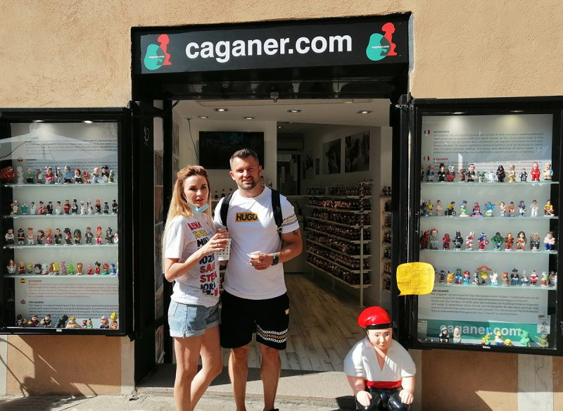 Tourists just outside the caganer shop in Barcelona