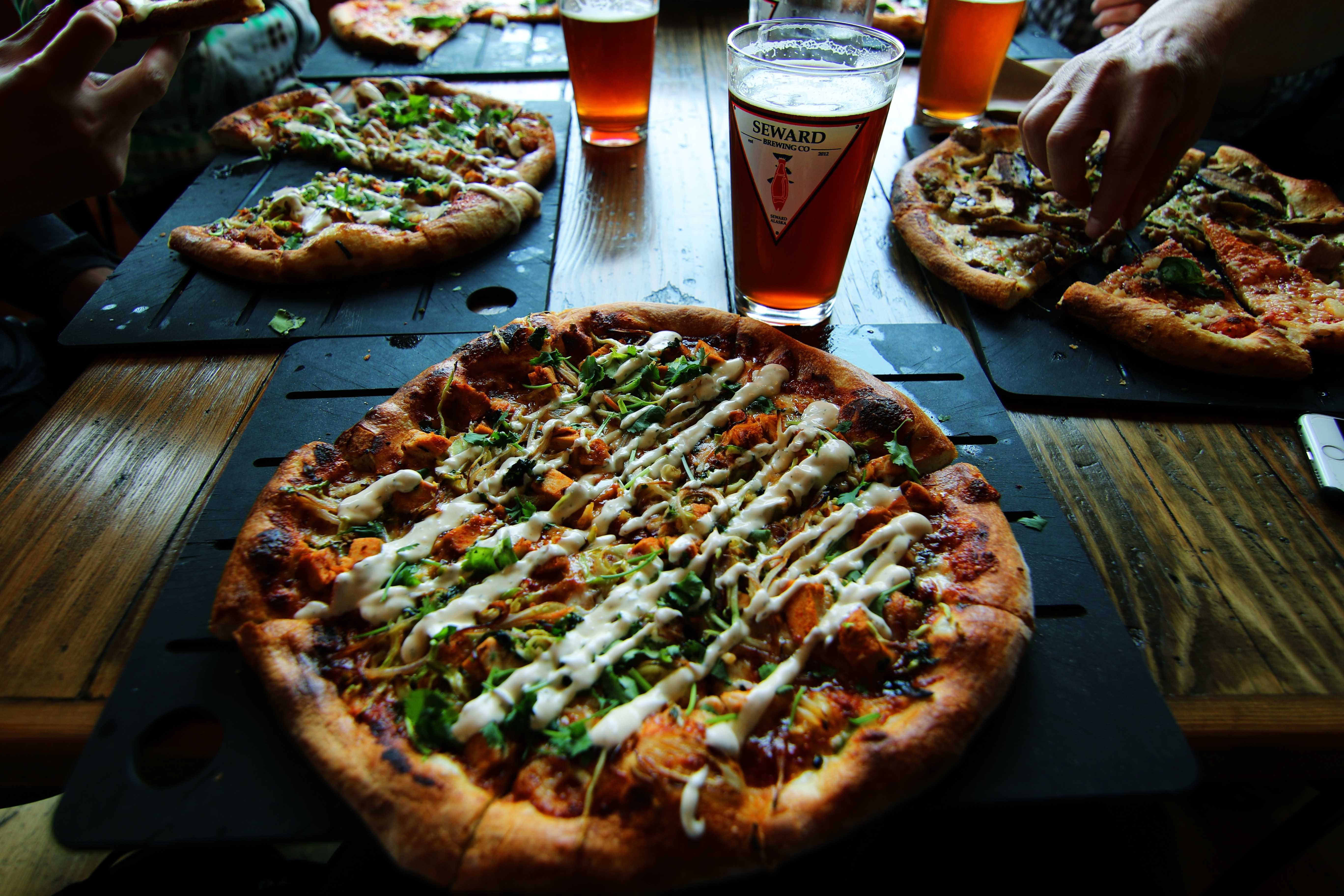 Pizza and beer on a table