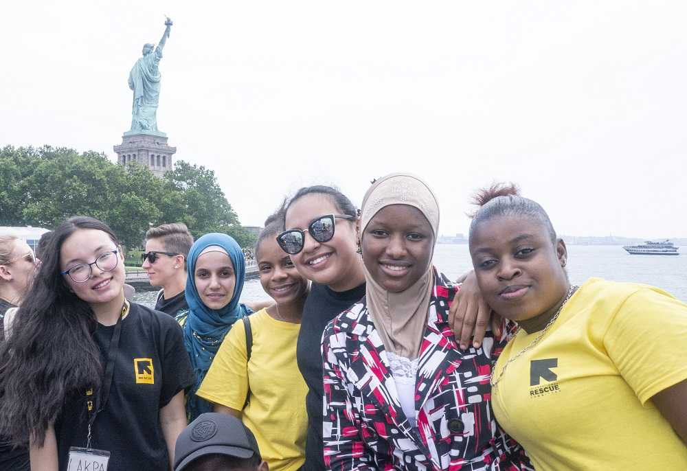 Students in front of Statue of Liberty
