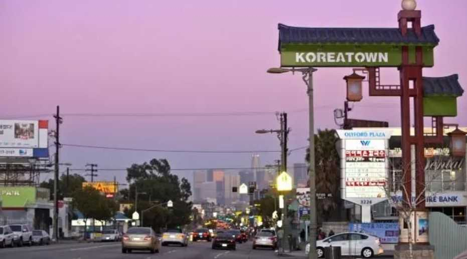 Koreatown sign with pink sky in background.
