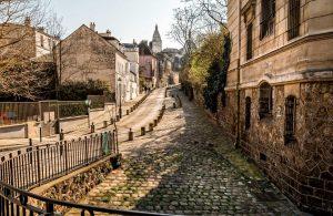 Cobblestone street in Paris Montmartre district.