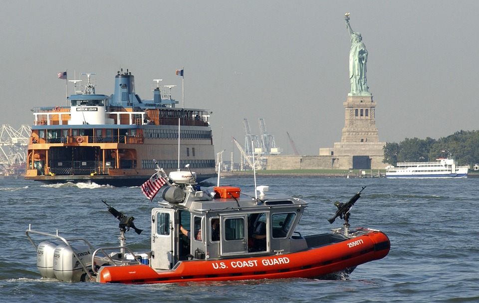 The Coast Guard waves hello to the Staten Island Ferry