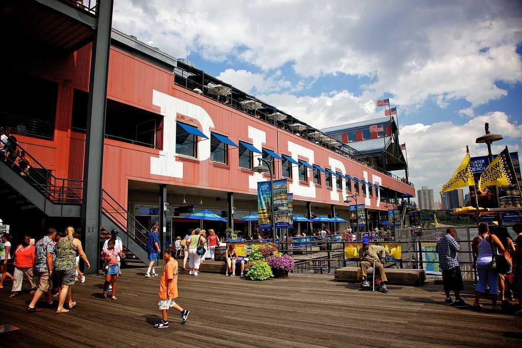 People walking on a pier