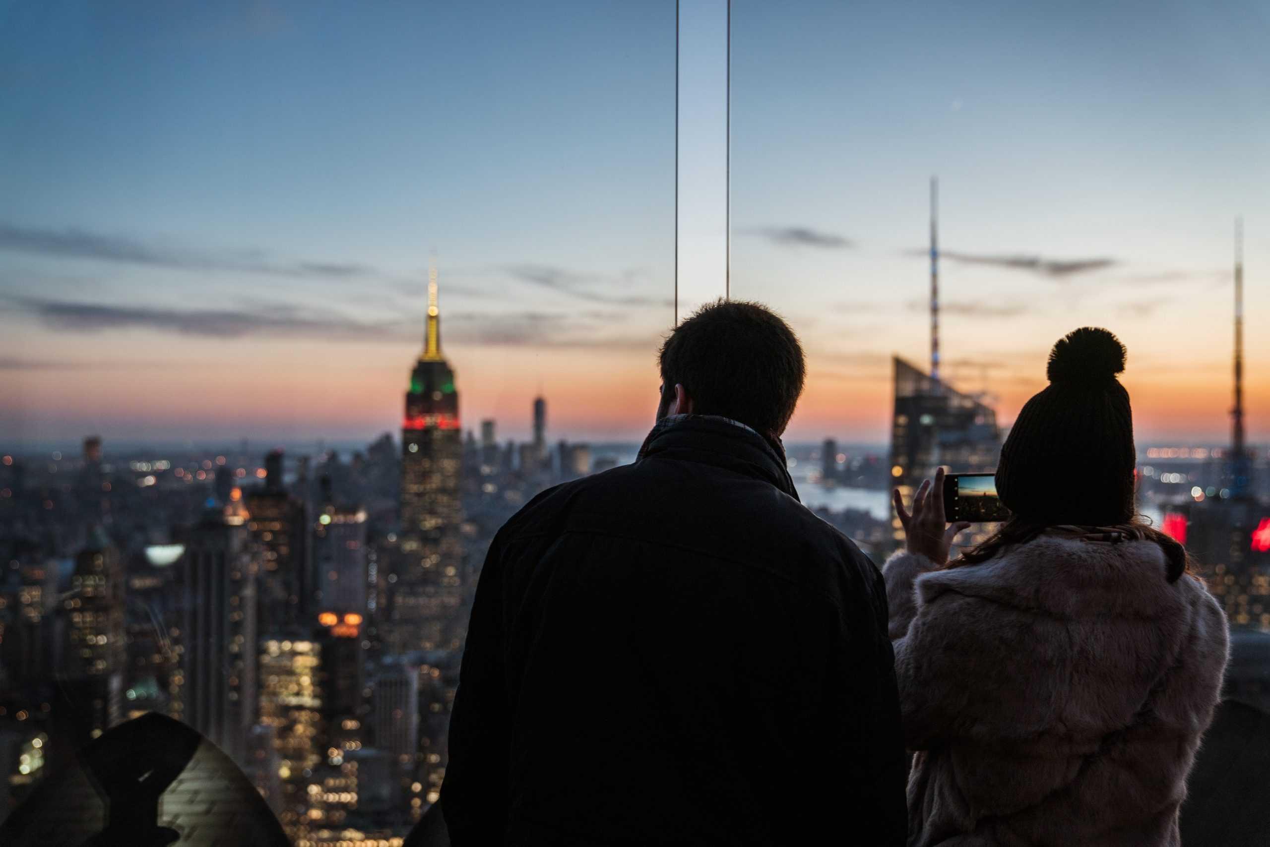 People looking at buildings