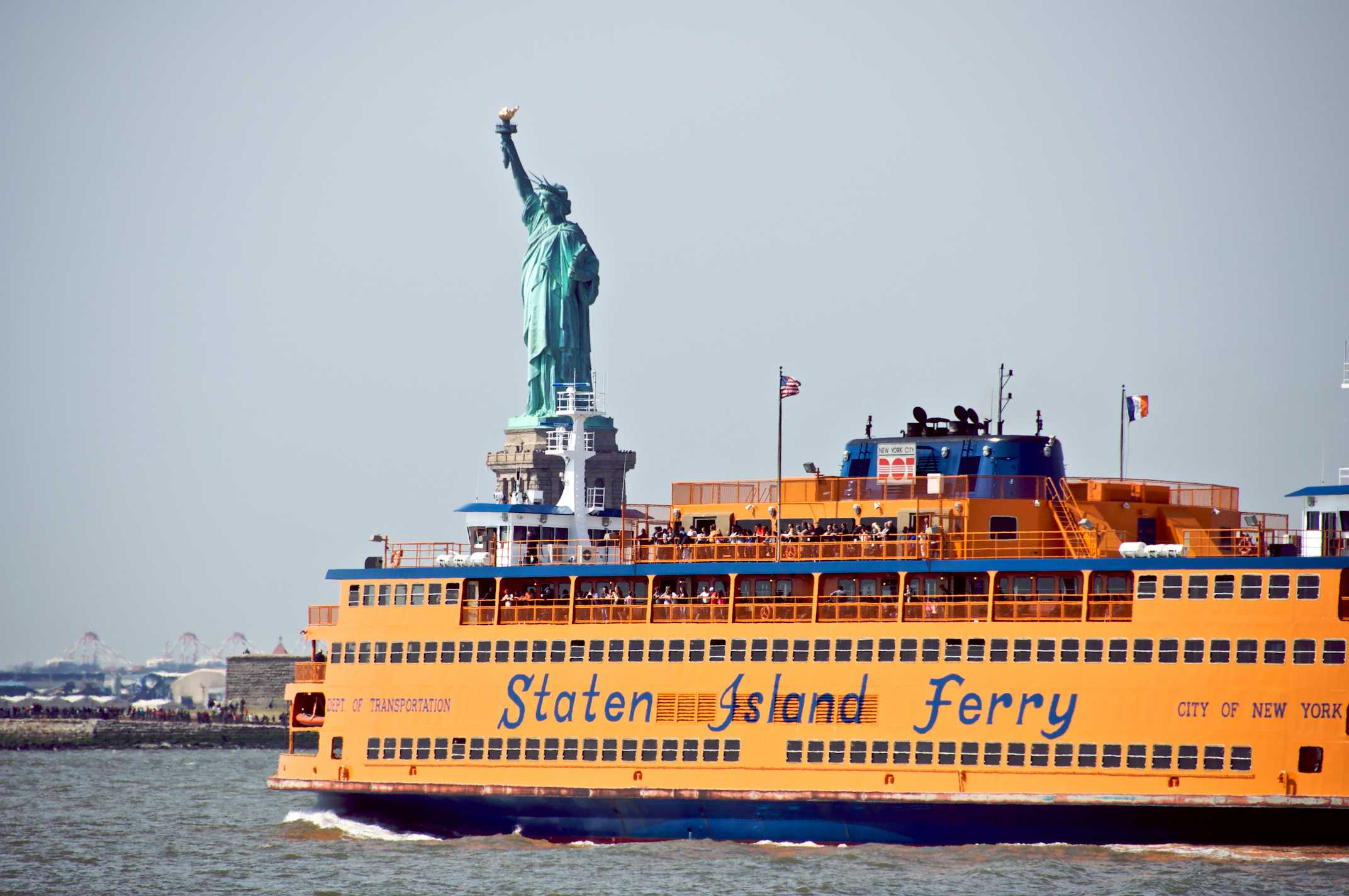 Staten Island Ferry with Statue of Liberty behind it