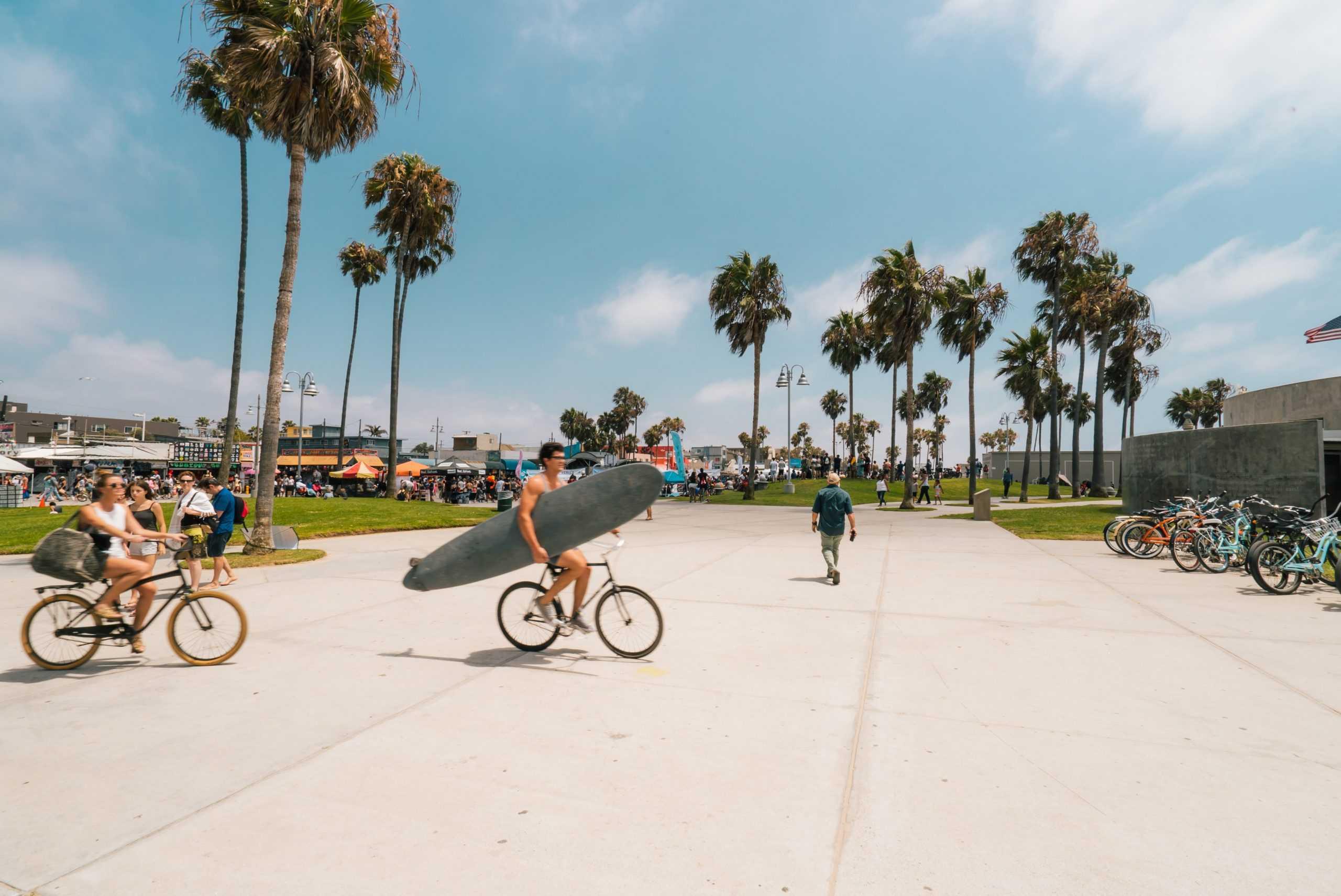 Biking with a surfboard
