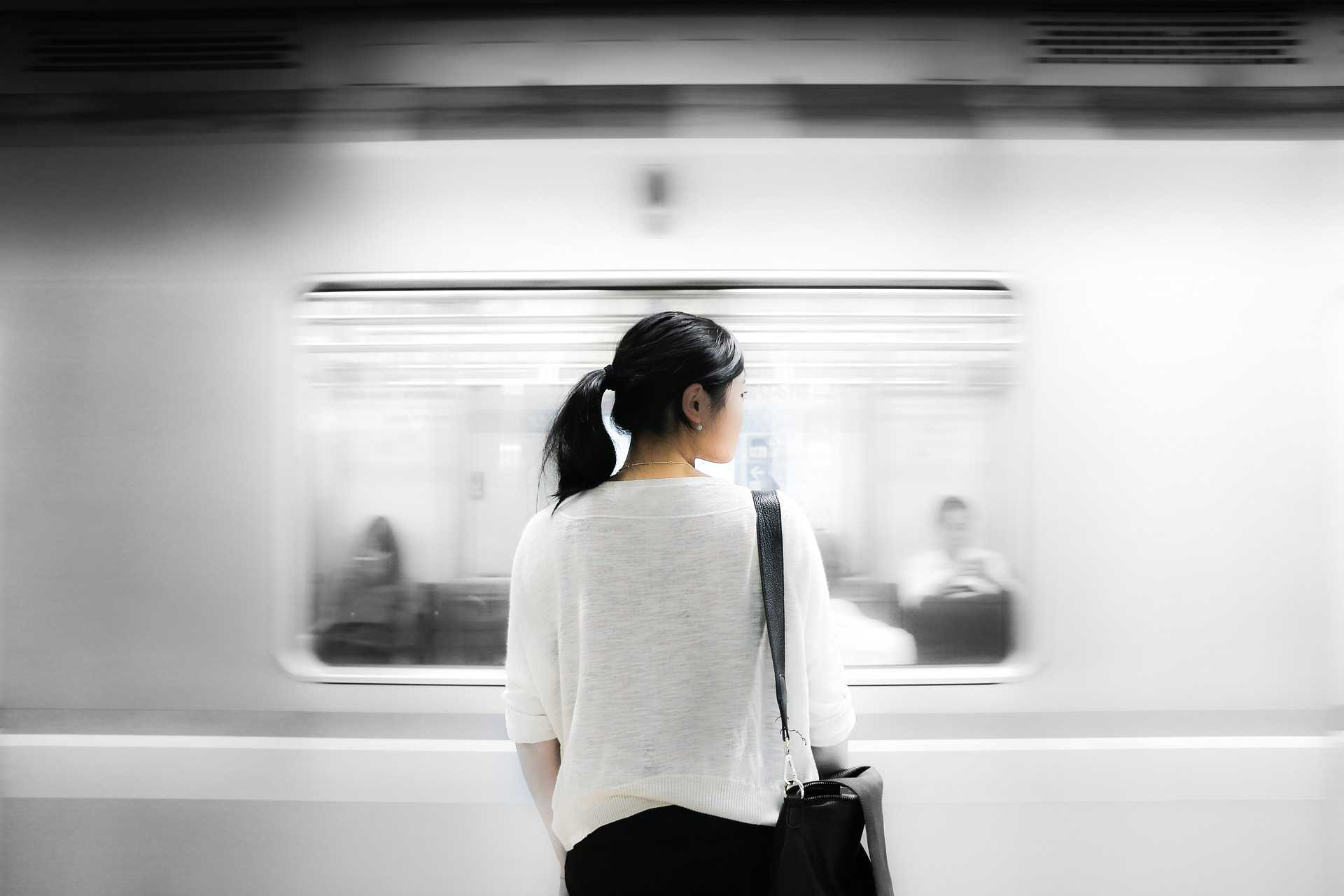 Woman in front of subway
