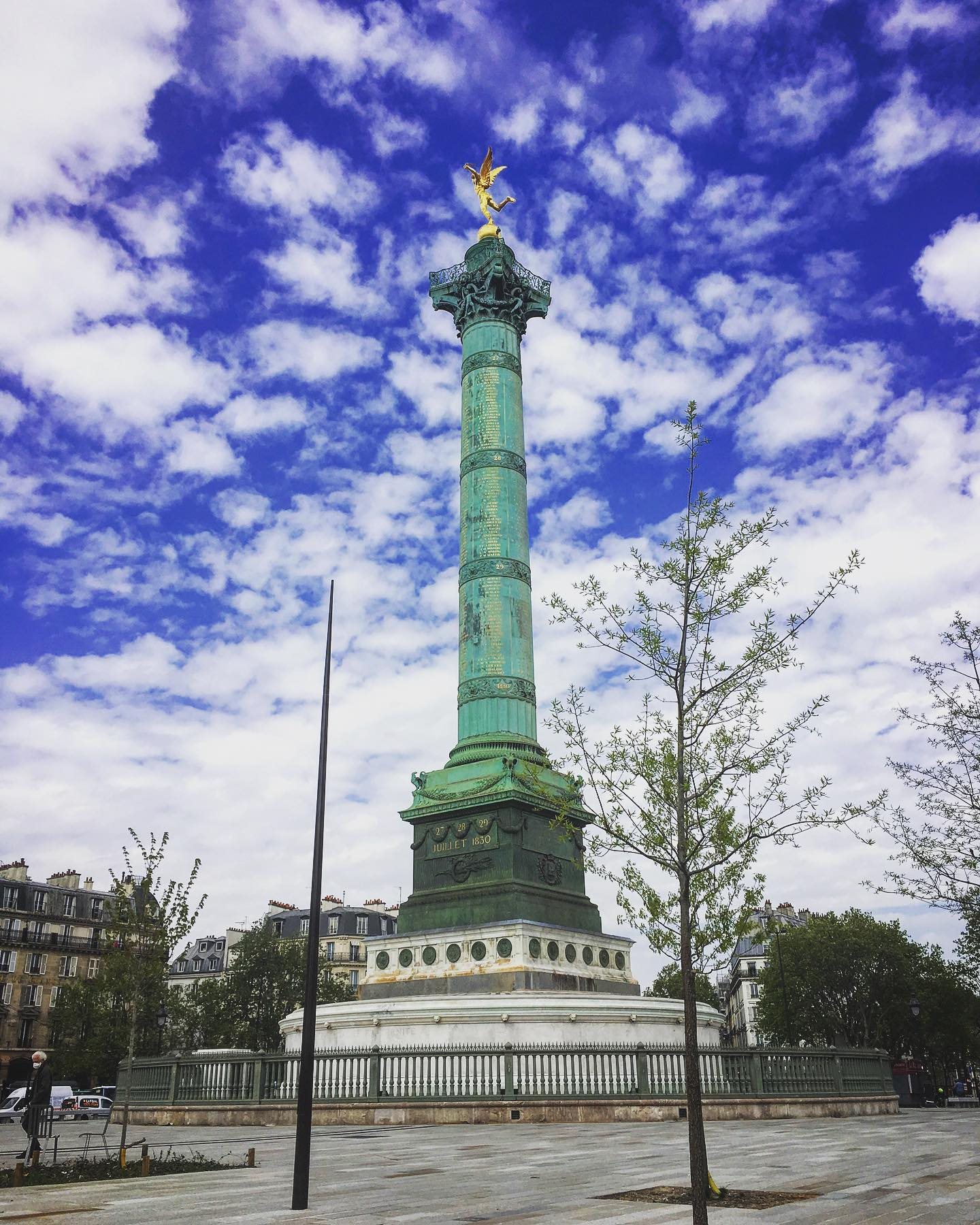 The Bastille monument with blue sky and white clouds