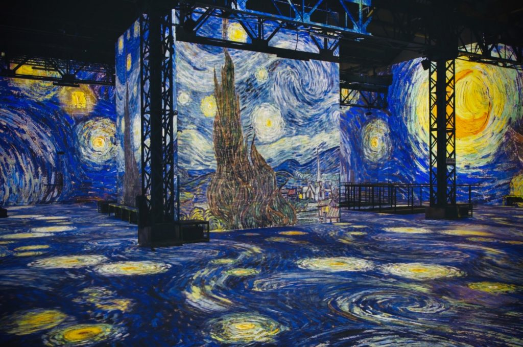 Van Gogh's Starry Night displayed on the walls of L'Atelier des Lumieres