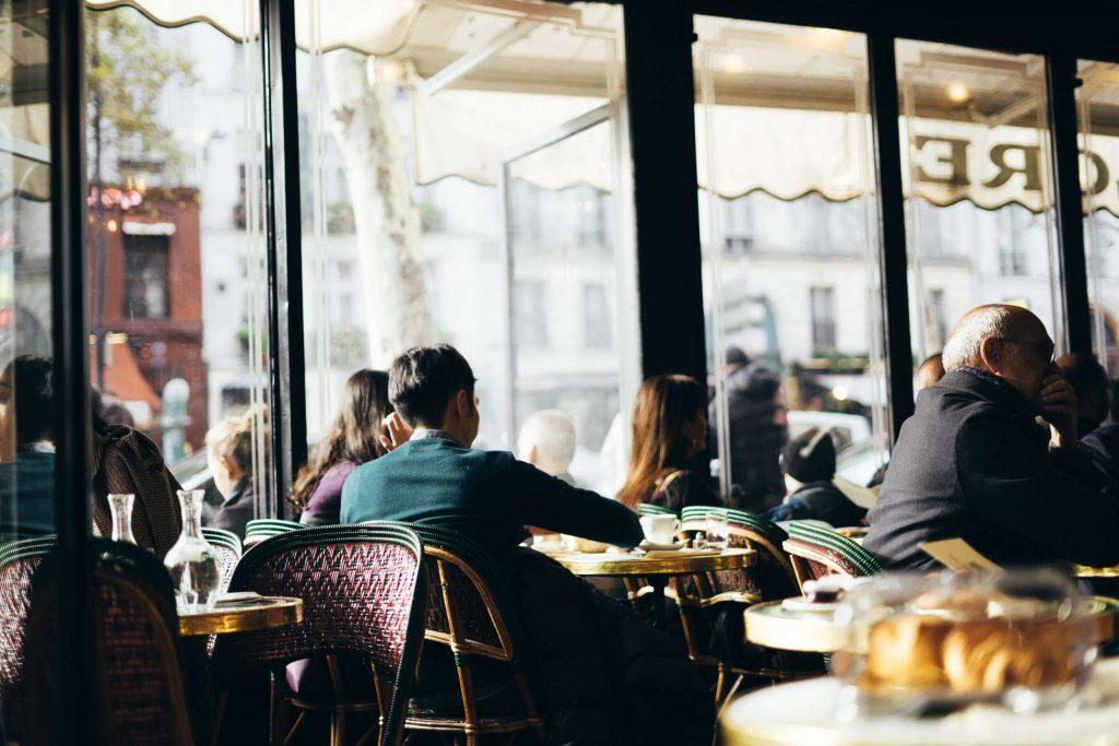 Inside a Parisian café famous for hosting legendary literature and artistic influences.