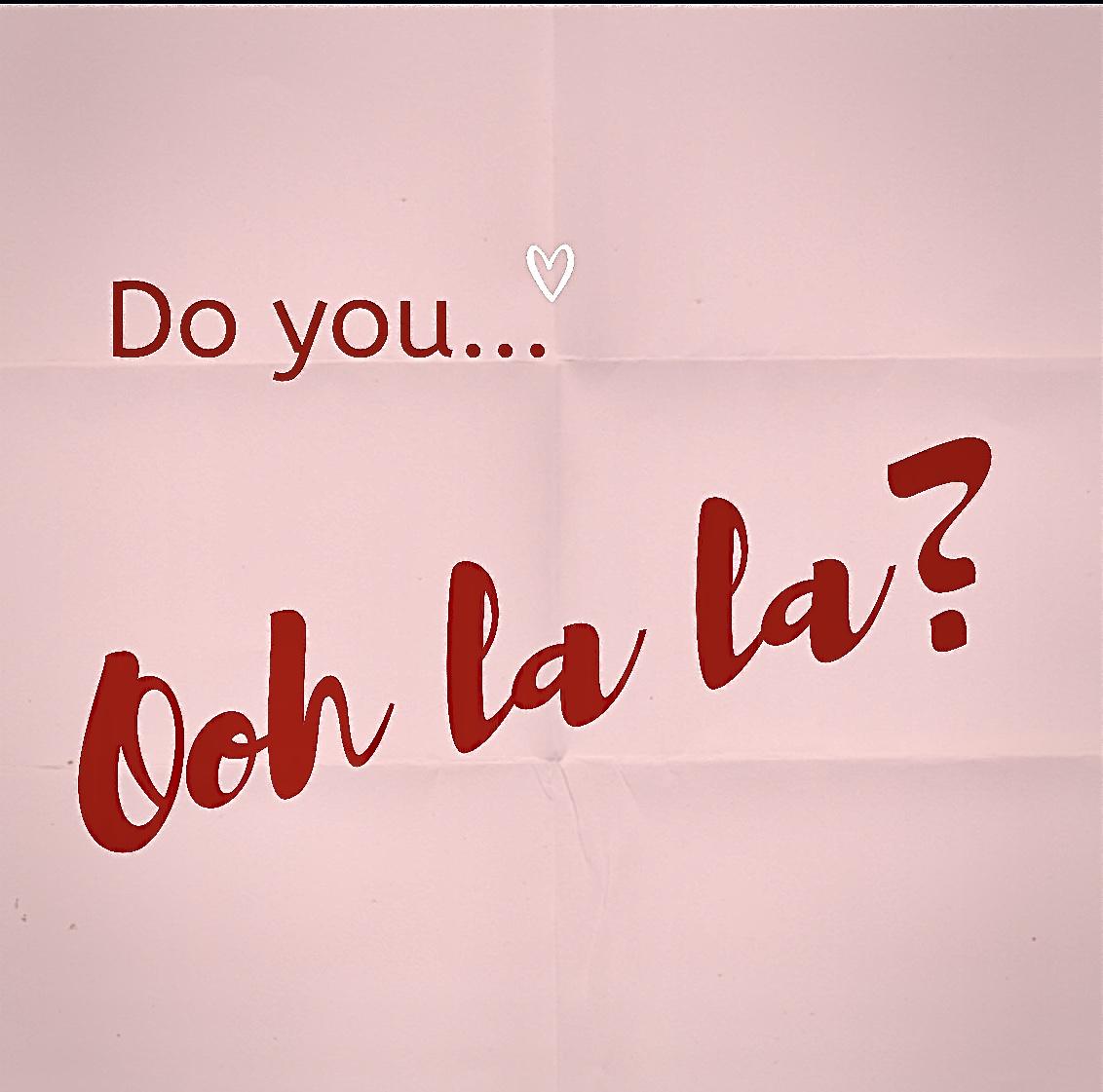"Pink folded paper that says ""Do you Ooh la la?"""