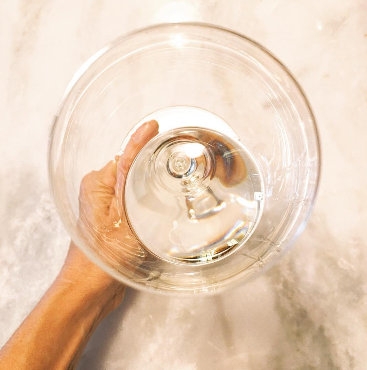 Wine glass with white wine on a marble table