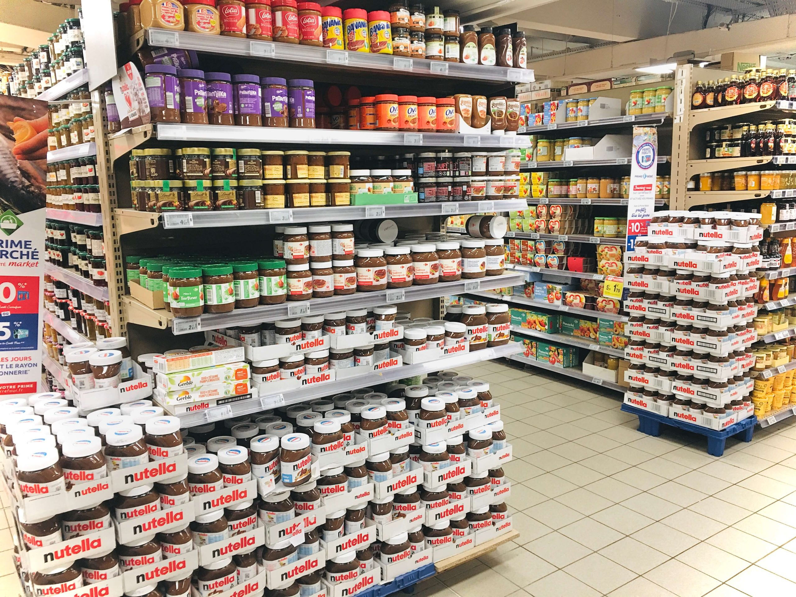 Many jars of pate a tartiner on shelves at the grocery store