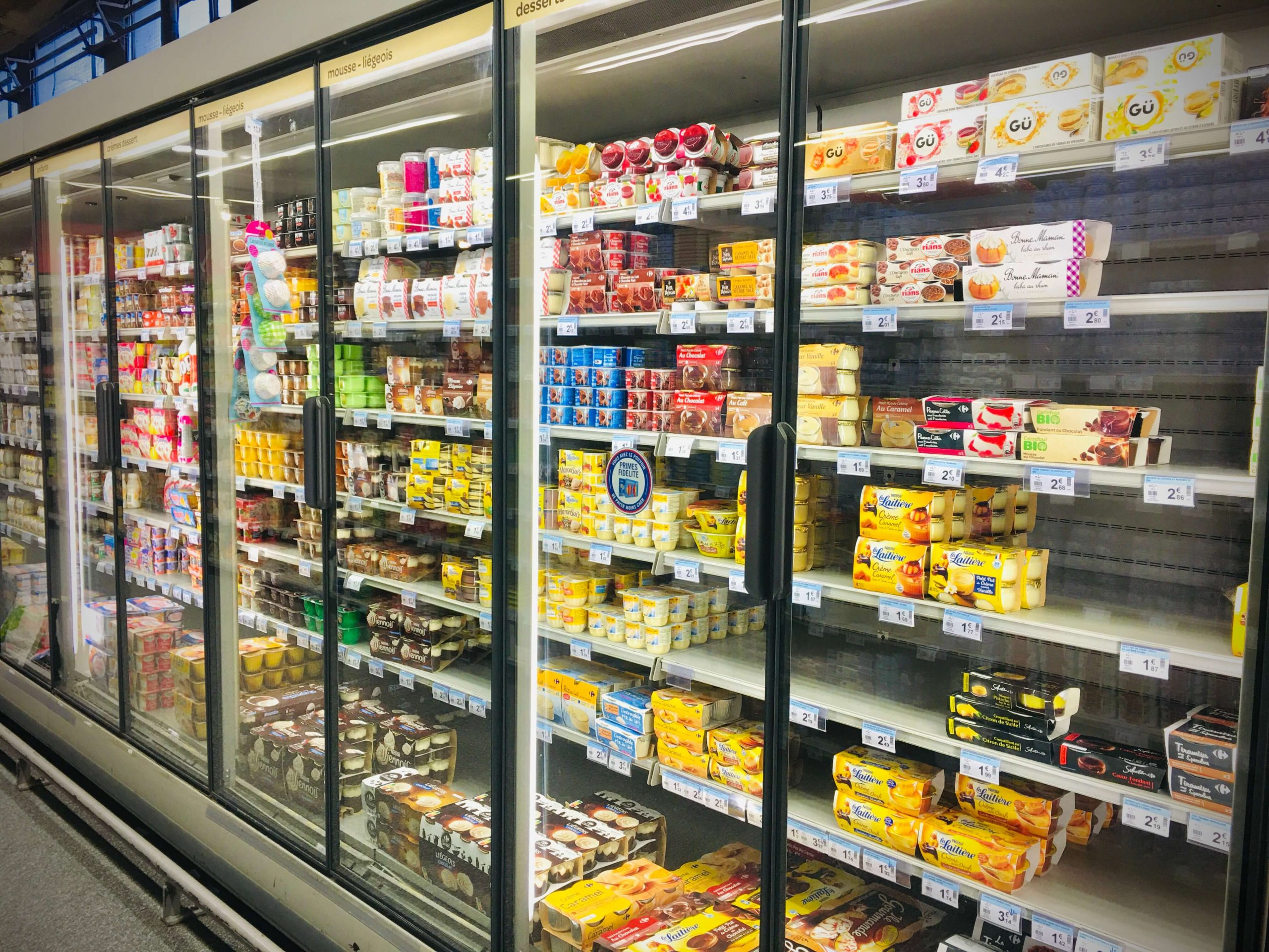 A refrigerator case of dairy products