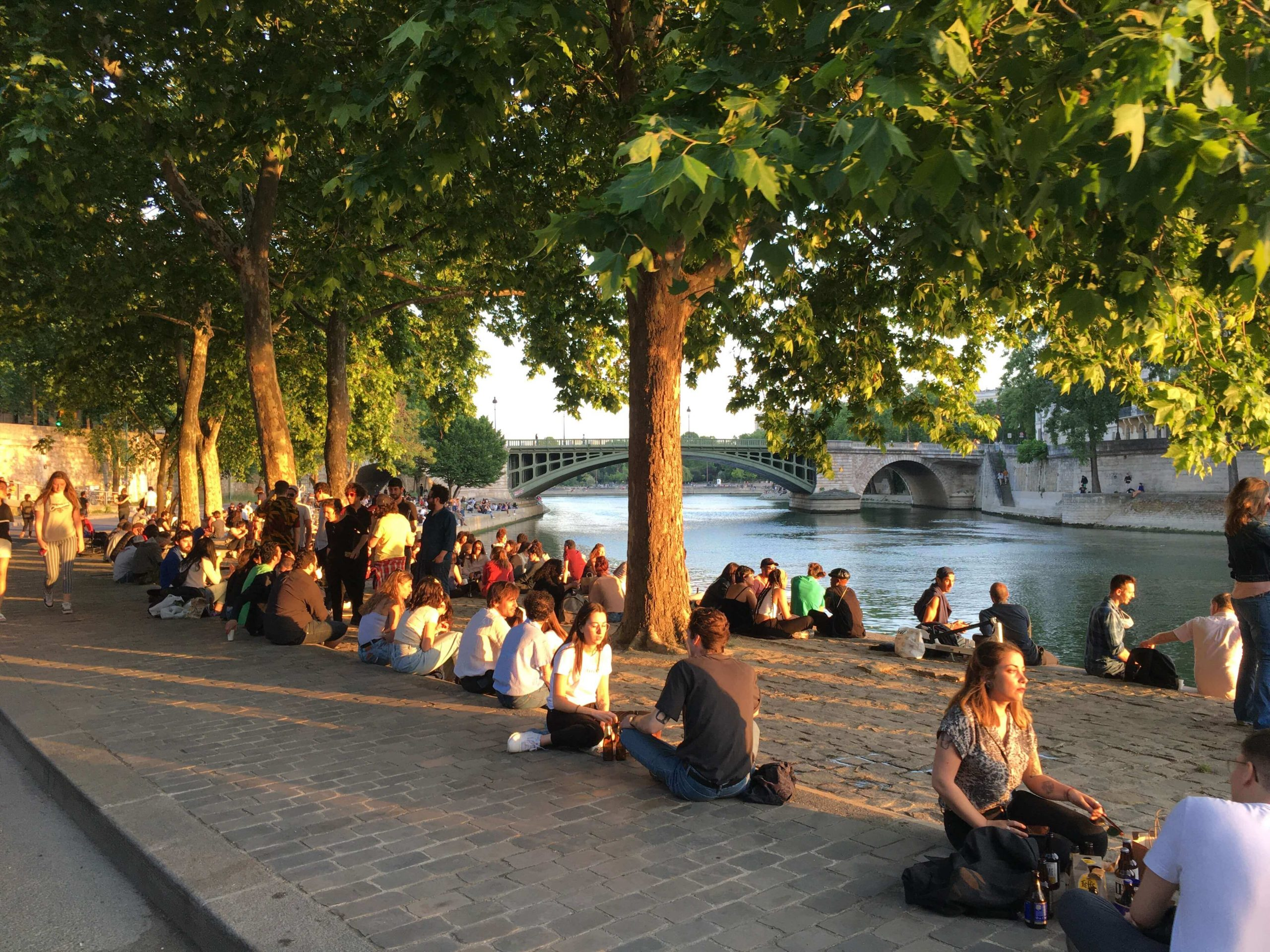 Parisians gathering on the banks of the Seine
