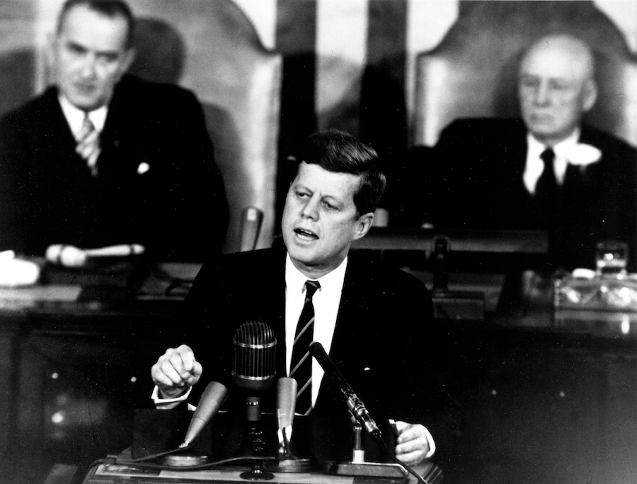 JFK speaking into a microphone