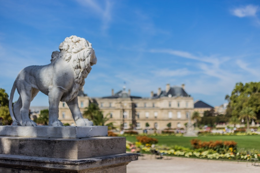 Luxembourg Gardens, largest in Paris, with lion statue in foreground