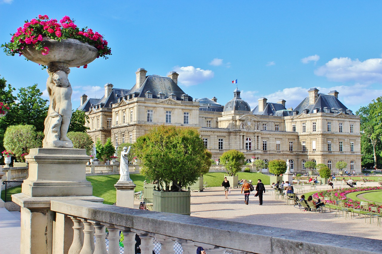 Luxembourg Gardens with cherubs holding flower pots in foreground and palace in the background