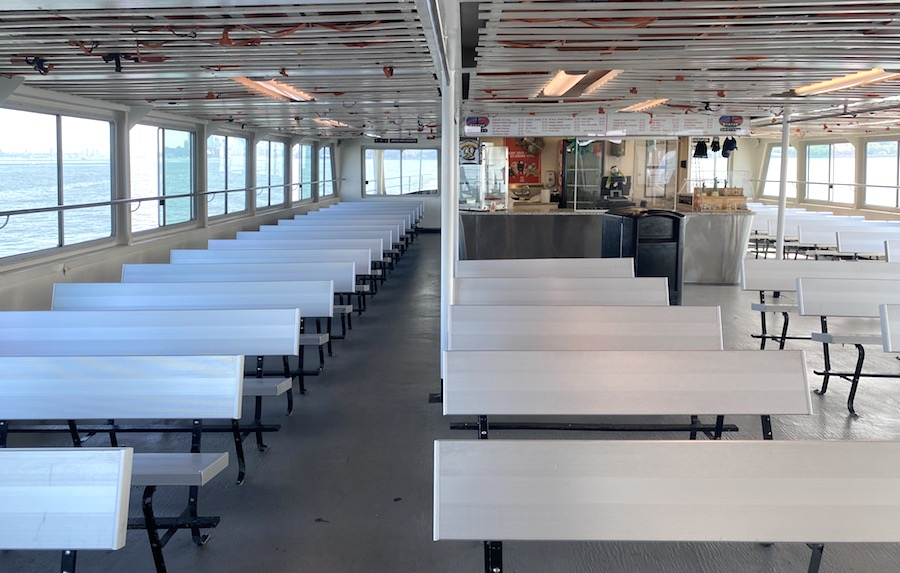 Ferry below deck for the ride to Liberty Island shown July 2020