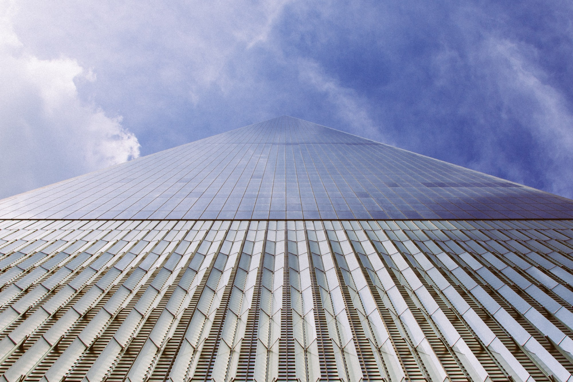 A view looking up One World Trade in NYC from the ground