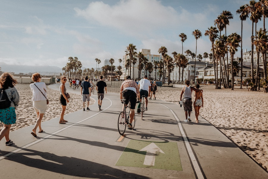 people biking on venice beach