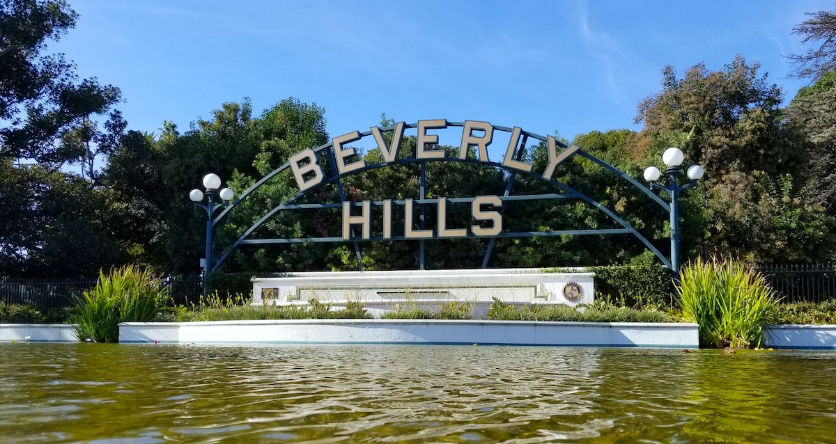 Beverly Hills sign in front of water