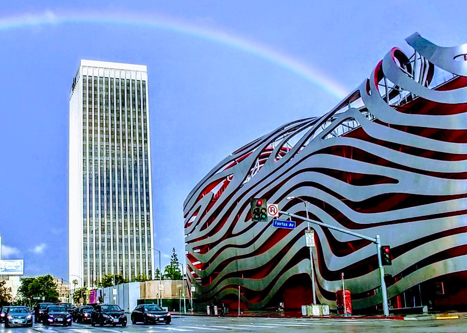 Exterior of the Peterson Automotive Museum under a rainbow