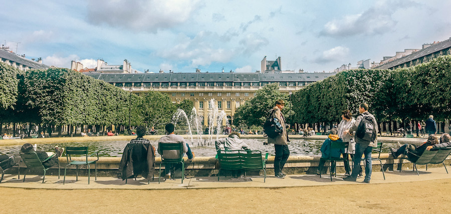 Loungers enjoying the fountain at Jardin du Palais Royal, located in a 17th century palace