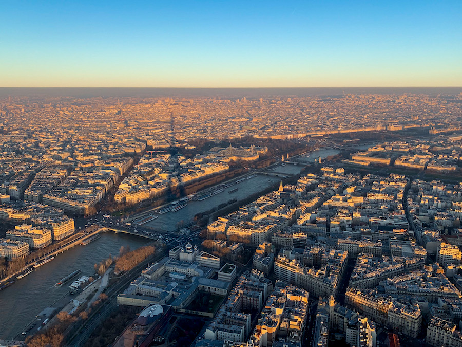 Rooftop views and the shadow of the Eiffel Tower from its summit