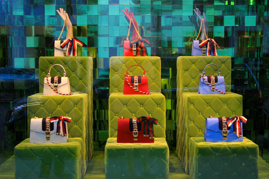 Luxury handbags on Rodeo Drive in a Beverly Hills shop window