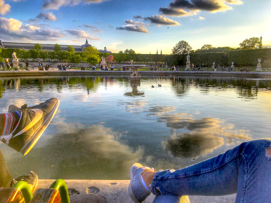 Sitting on the green chairs at a fountain in Tuileries Garden, the oldest garden in Paris