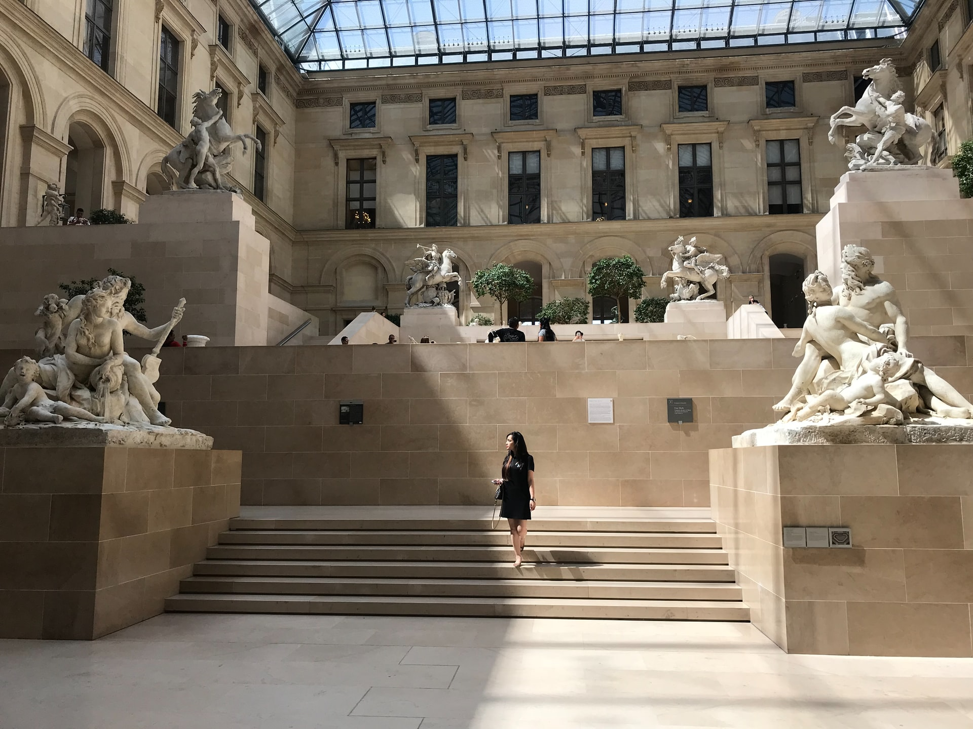 Louvre floors of art with sculptures and steps