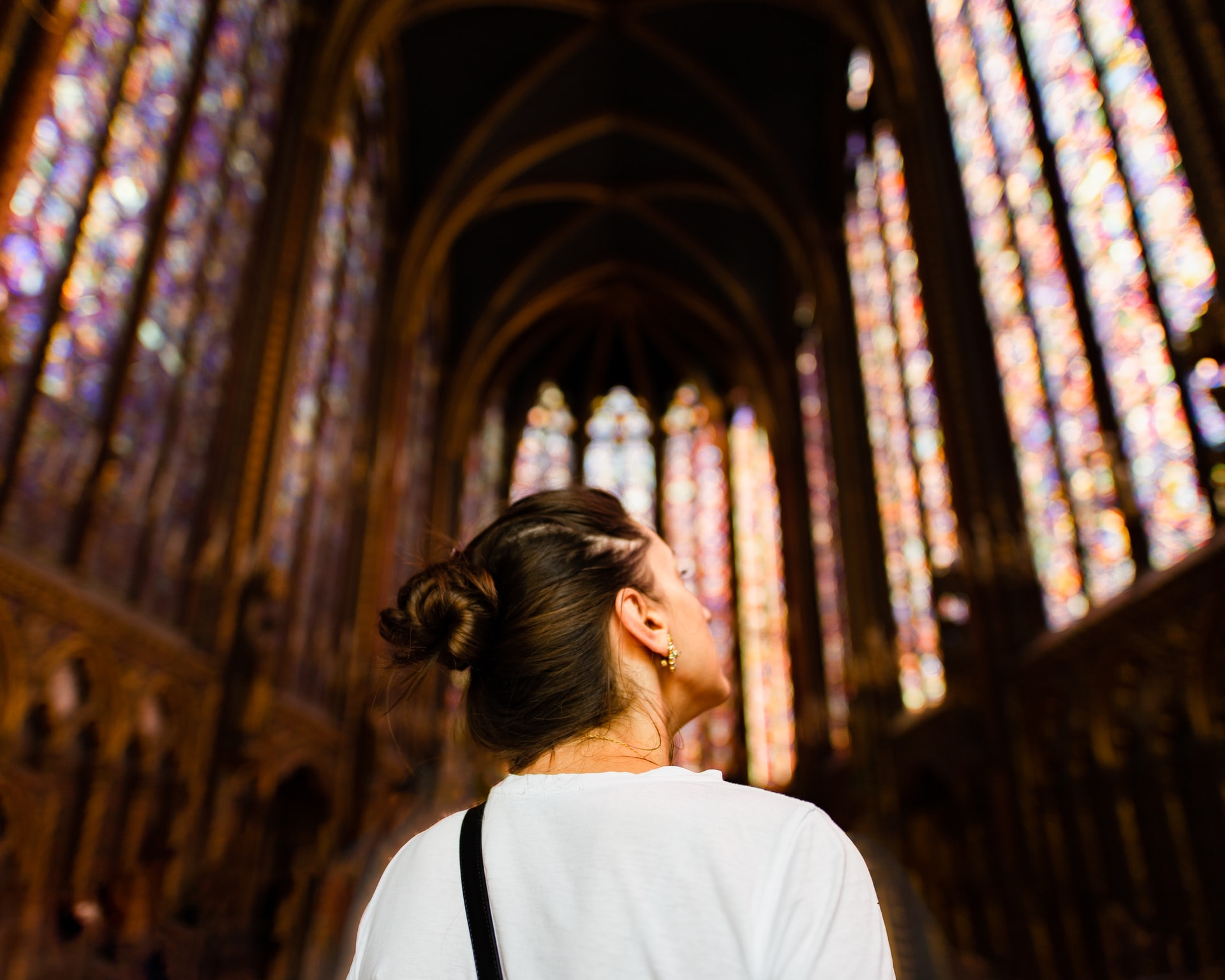 Paris traveler looking at scenes depicted on the stained glass in Sainte-Chapelle