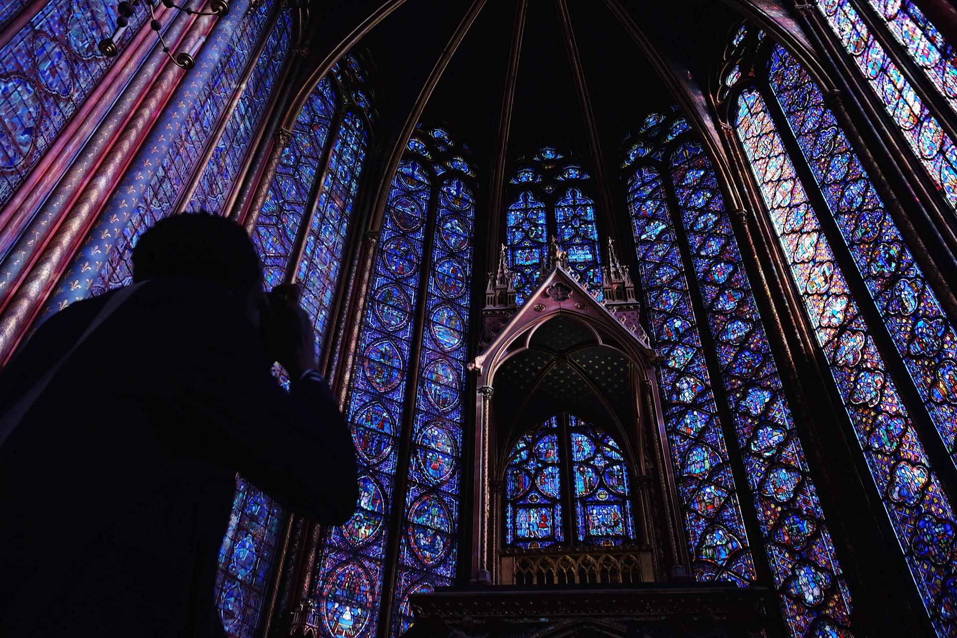 Photographer inside Sainte-Chapelle in Paris