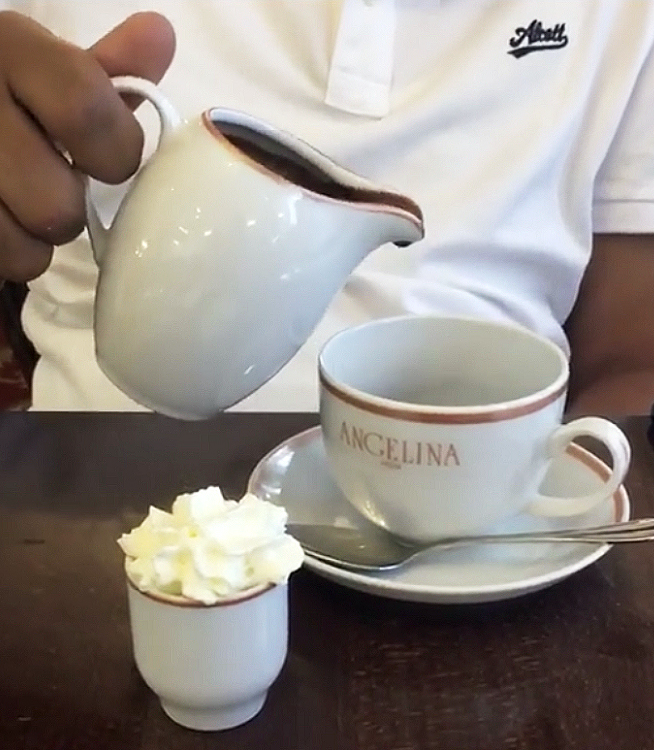 Pouring hot chocolate at Angelina at Versailles near Paris