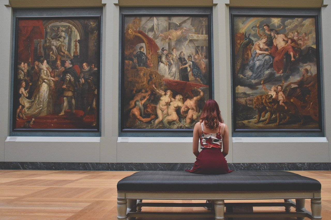 woman looking at art in the Louvre
