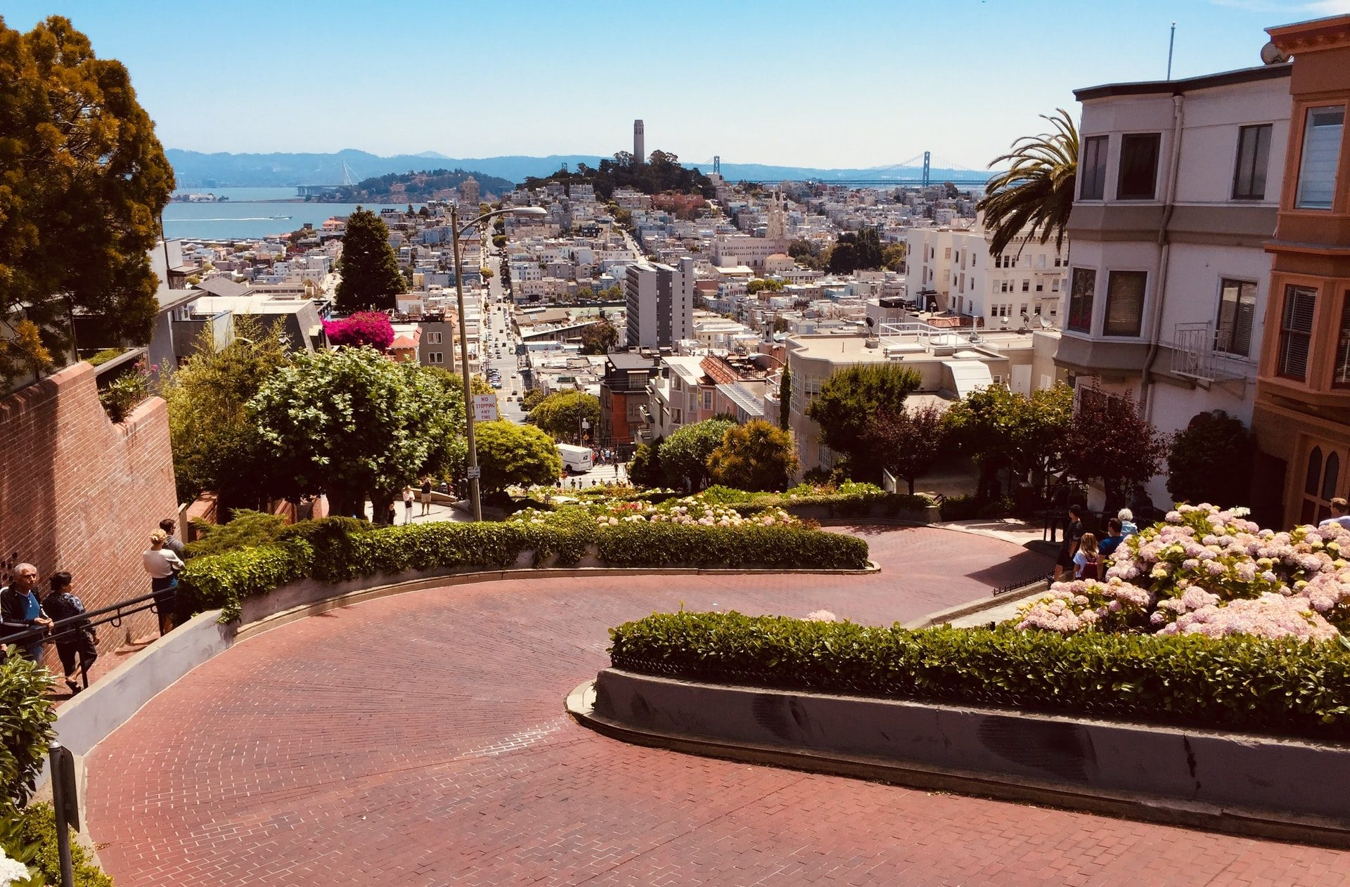 Lombard Street in SF with view of Bay Bridge