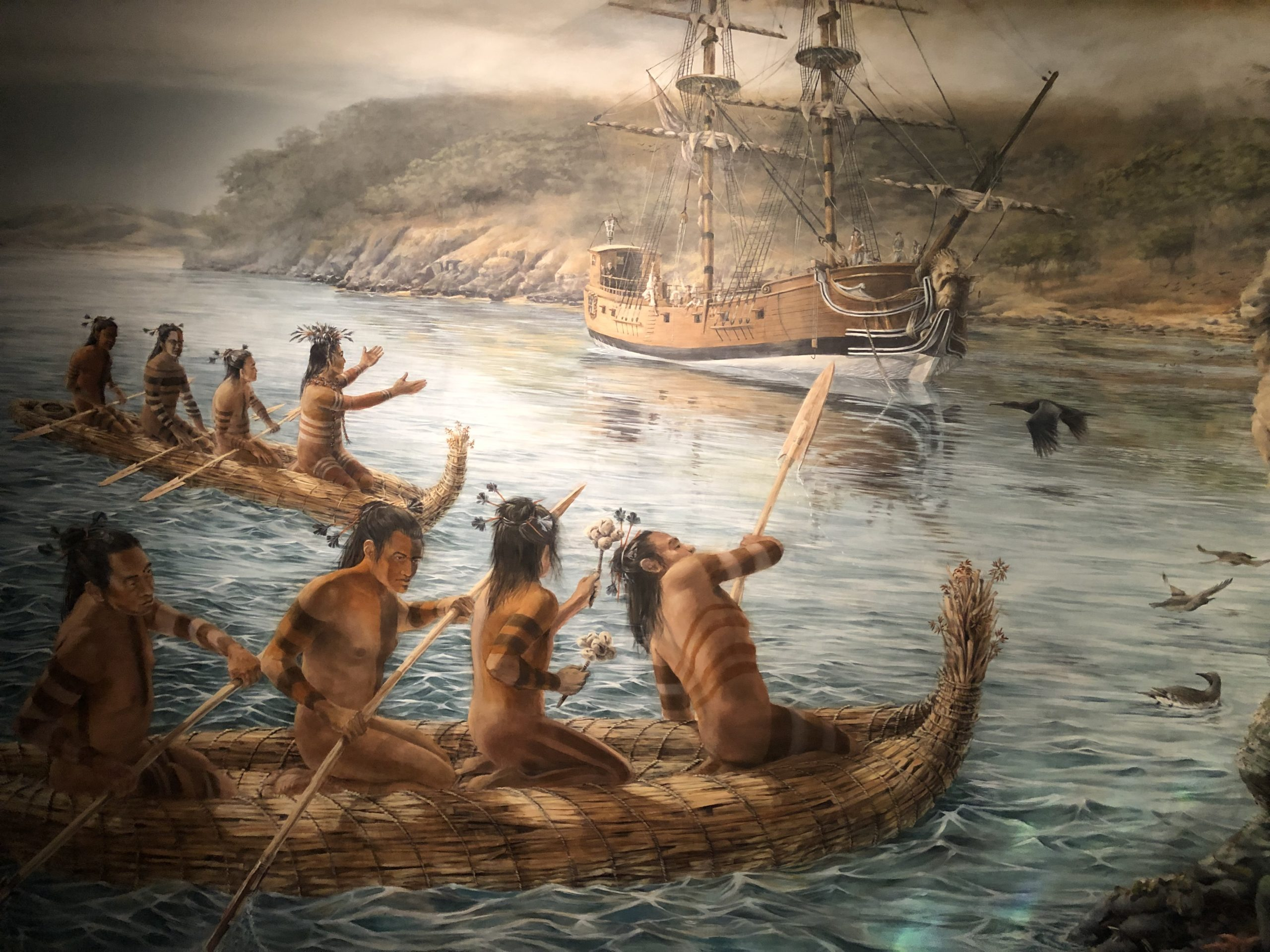 painting of Native Americans in canoes on display at the Maritime National Historical Park Visitor Center