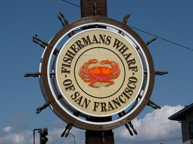 Fishermans Wharf sign with crab in the center