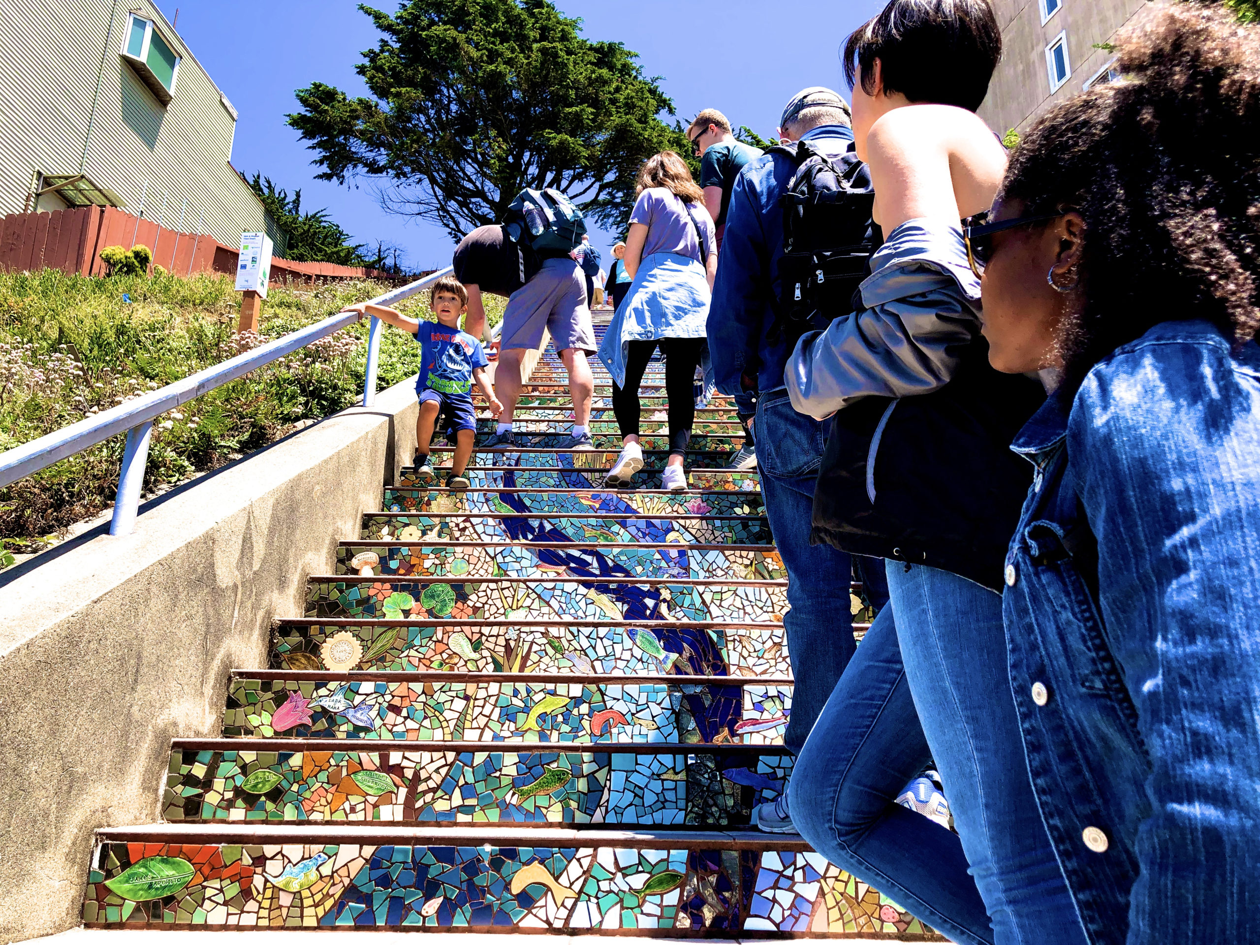 tour group climbing up 16th Avenue mosaic steps