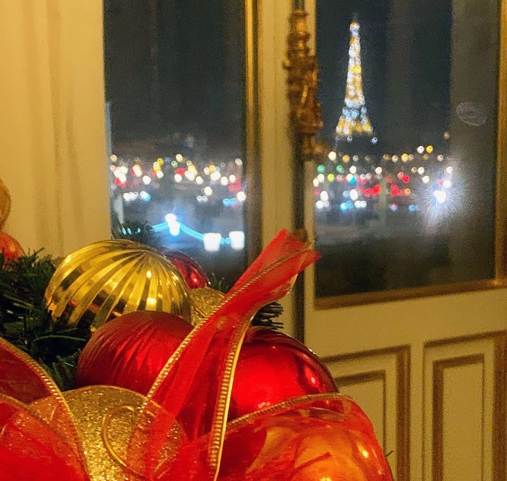 Christmas decor and dinner with a view of the sparkling Eiffel Tower at night in Paris