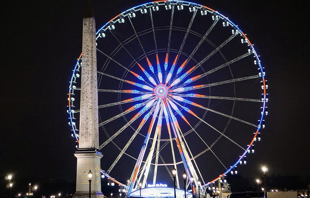 Ferris wheel in Paris lit up on a December night