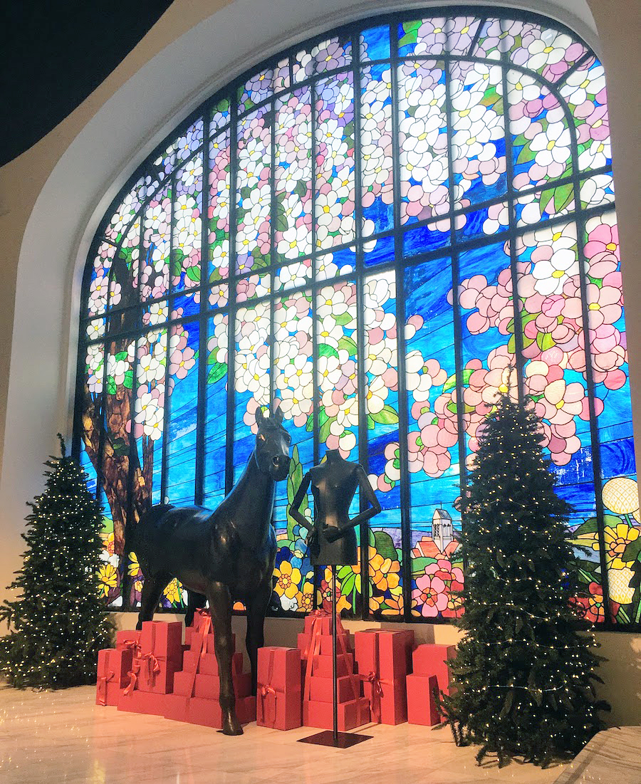 Stained glass in behind Christmas trees in Paris in December