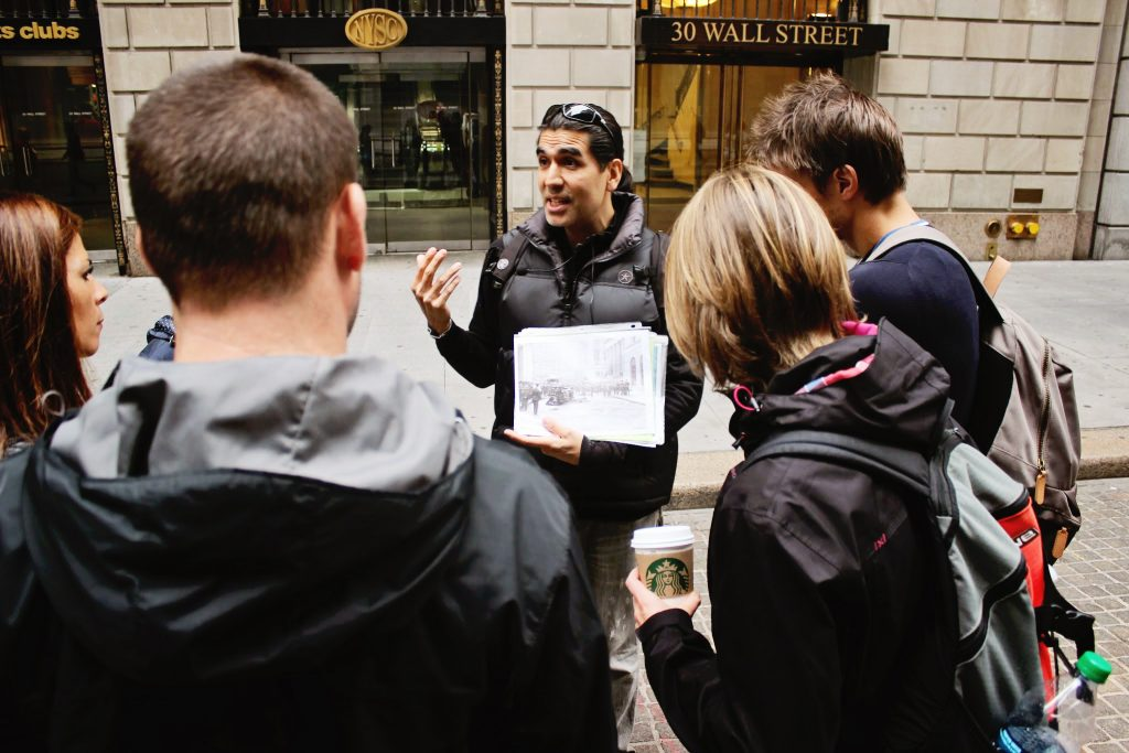 Wall Street tour guide with small group