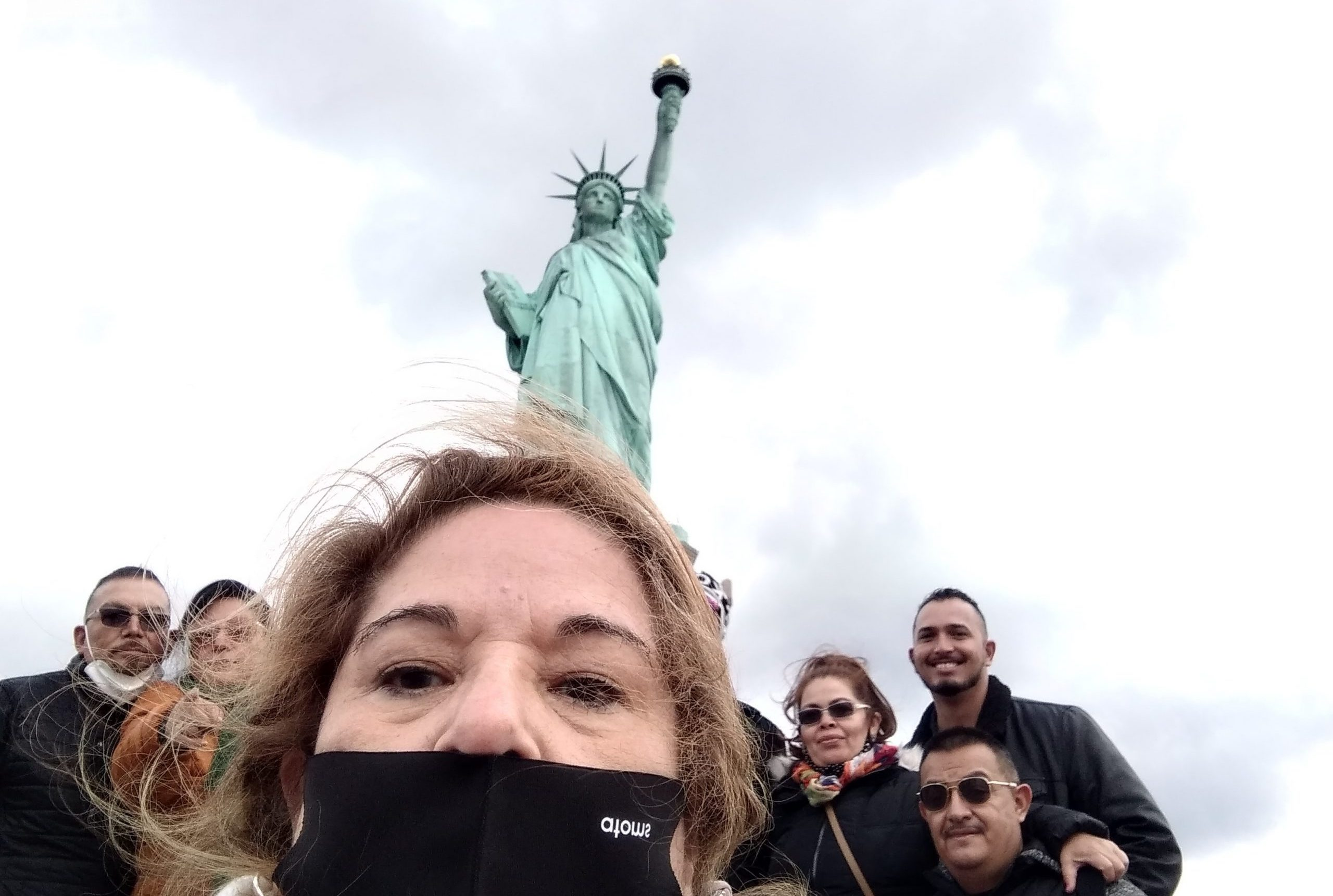Tour group wearing masks at Statue of Liberty during COVID-19