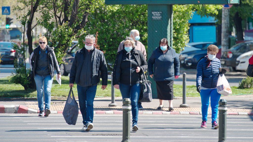 Pedestrians walking with masks