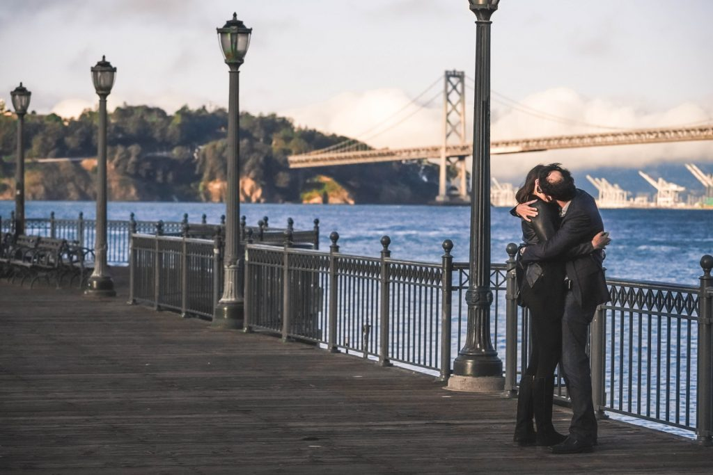 Couple kissing at the Embarcadero in SF