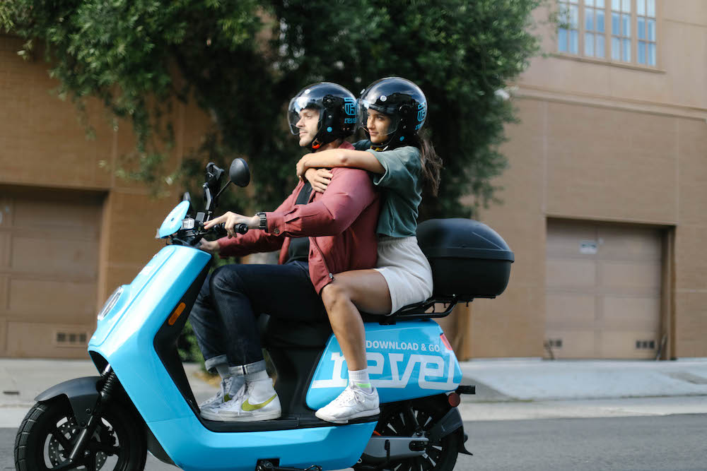 Couple riding Revel in SF