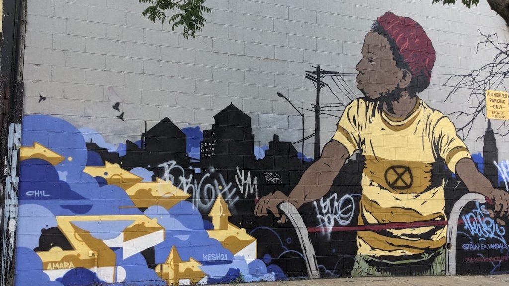 """Boy on Bicycle"" mural in Bushwick"