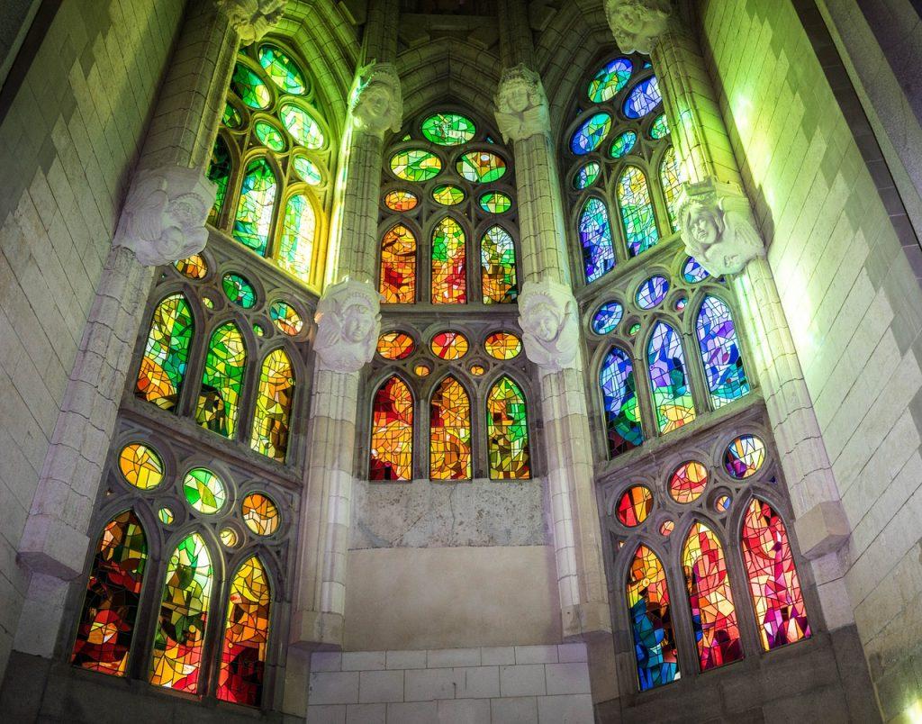 Sagrada Familia basilica in Barcelona with lit stained glass interior